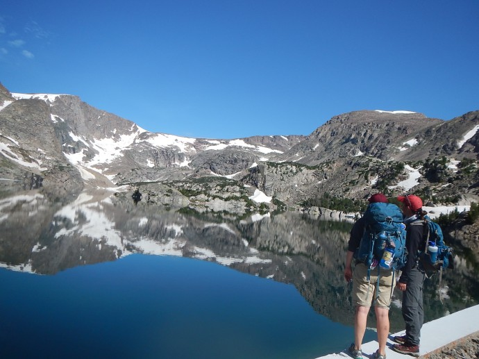 2017: Fieldwork buddies Cameron and Claire look out over Glacier Lake, Beartooth Mtns, MT