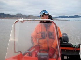 2011: Svalbard- they let me drive a boat! Note the glacier behind me