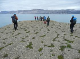 2013: Svalbard, patterned ground underneath my classmates feet as we look at the Quaternary stratigraphy